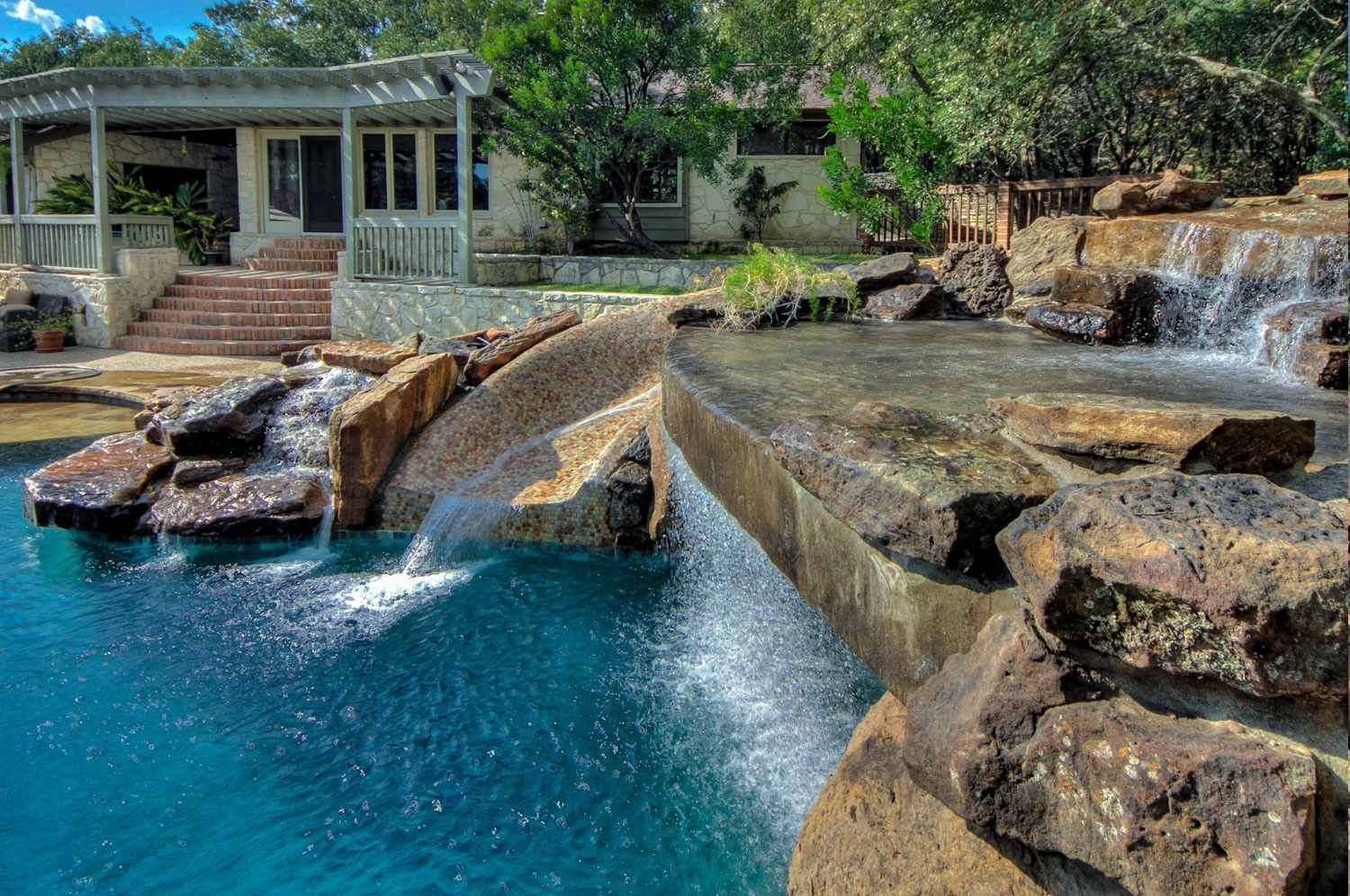 Pool remodel with rock waterfall feature.