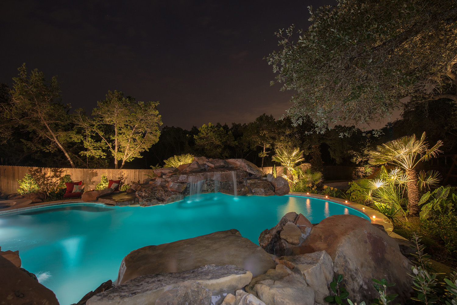 Automated technology and LED lighting make this custom pool stunning at night.