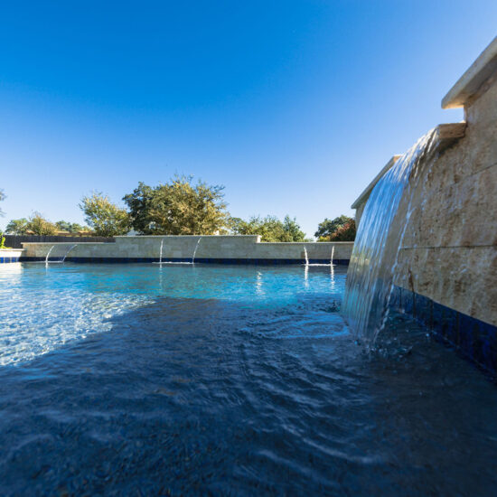Waterfall features in this San Antonio pool create a calm and relaxing environment.