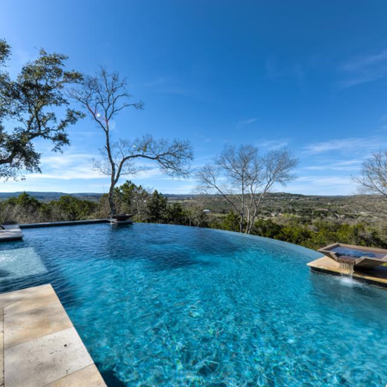Modern pool with infinity edge design and beautiful water features.