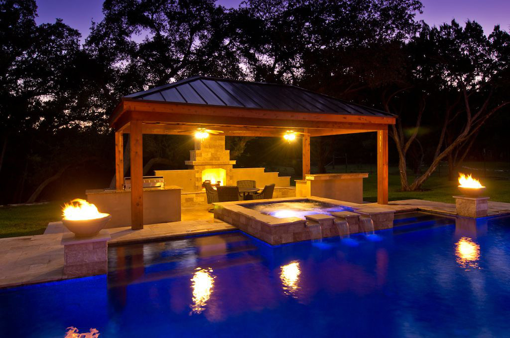 Modern Pool at Night with spillway water feature