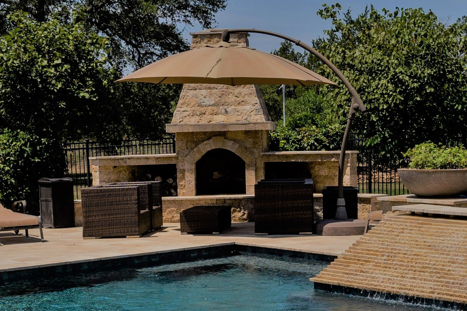 fireplace pool feature in a modern pool design